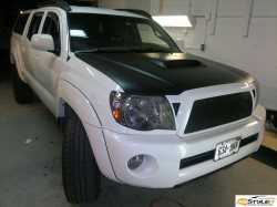 Toyota Tacoma matte black hood wrap. Head lights tint