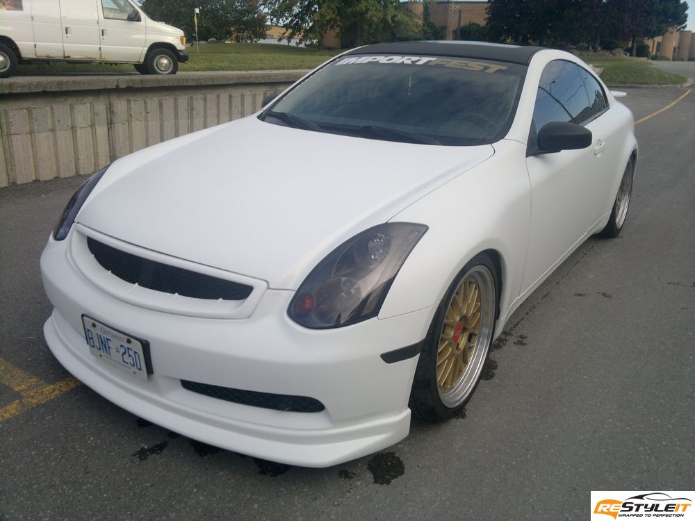 Infiniti G35 Matte White full body wrap. Carbon fiber exterior and interior finish. Head and tail lights tint