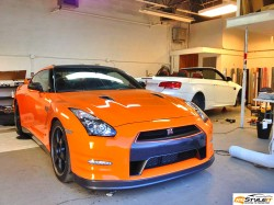 Gloss Orange wrap with Carbon Fiber roof, mirrors and spoiler finish