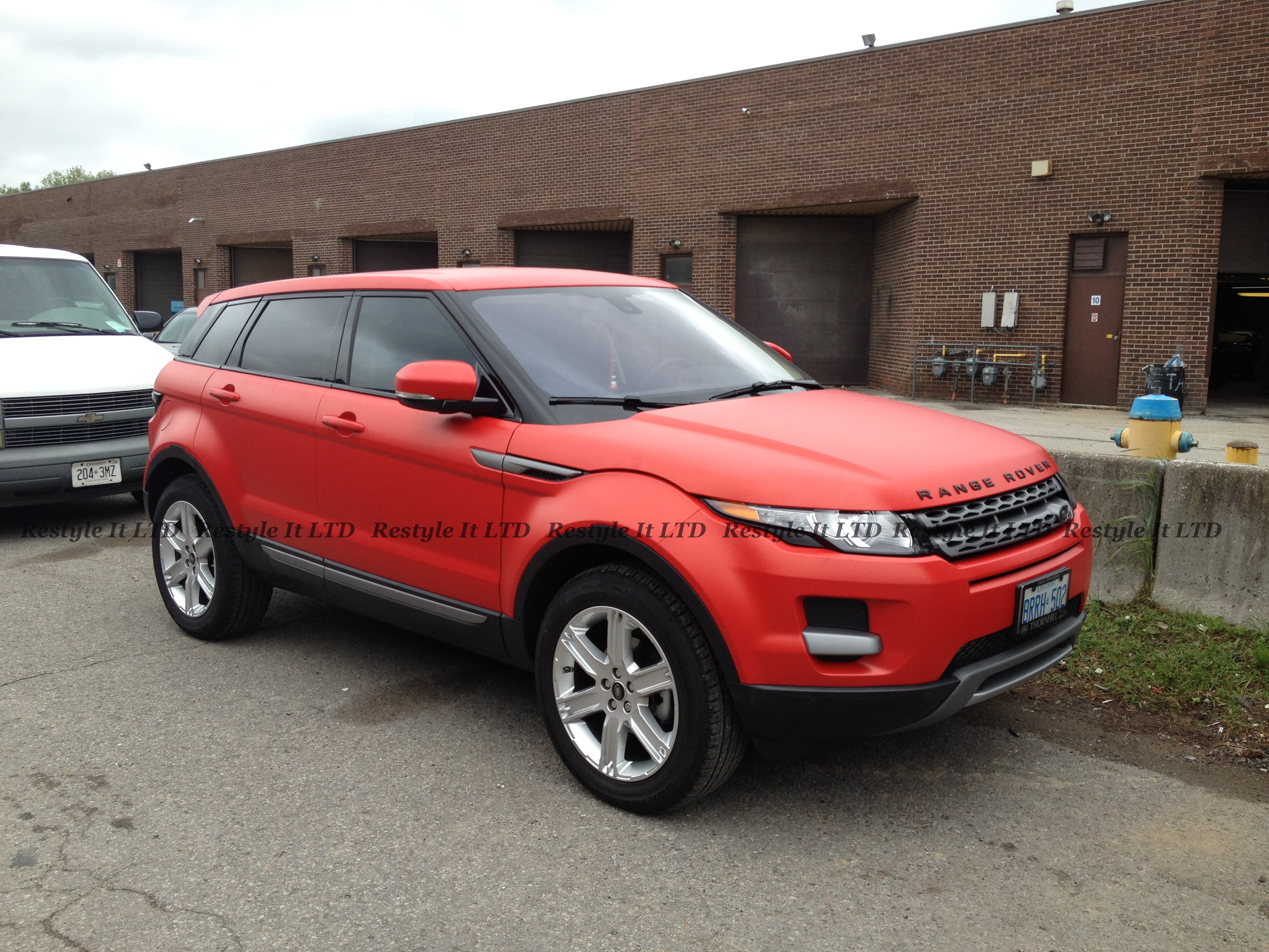 Matte Cardinal Red Range Rover Evoque Vehicle